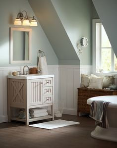 The country-style design includes a premium 2 in. thick AB Composite vanity top and offers valuable storage solutions and complements your bath decor.