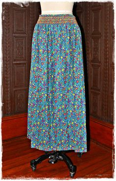 Vintage 60's BOHEMIAN festival skirt... All done in a colorful FLORAL pattern in a WHIMSICAL print... Elastic, STRETCH waistband is accented with embroidered design... LOVE!