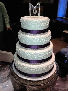 This cake is the closest to what I want. I think I want a 3 tier square cake though instead of round. I love everything else about this cake!