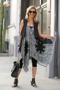 On the blog our Black and White Paisley print Handkerchief tunic/dress paired with Faux Leather Vest both available at www.jacketsociety.com