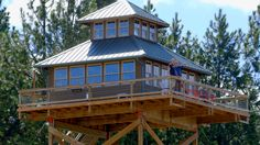 Treehouses Aren't Just For Kids Anymore: If you're willing to climb four flights of steep stairs, you can call this treehouse without the tree your home.