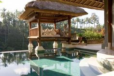 Poolside at one of the 25 villas that make up the 5 star Viceroy Bali Resort in the Valley of the Kings.