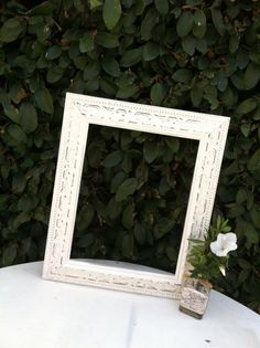 This ornate Vintage Chic Picture Frame has been hand painted Antique White and distressed for a perfectly cottage chic look then sealed for