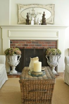 I should get two large urns like this for my fireplace.