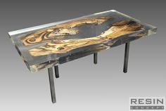 Coffee table made of epoxy resin and walnut. 110 cm x 55 cm x 6 cm - table top.