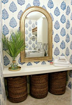 Easy and cheap...plywood, trim, stencil, baskets.