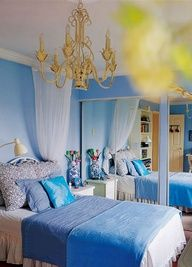 Blue bedroom with gold and white accents