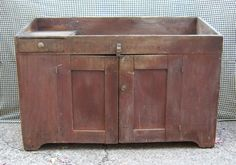 """EARLY 1800S DRY SINK WITH OLD DRY RED PAINT. MORTSE & TENONED DOORS, DOVETAILED DRAWER WITH THE RAISED PANEL BOTTOM BOARD. THE SIDES OF THE SINK ARE MADE FROM ONE BOARD 17 3/4"""" WIDE X 1"""" THICK, OLD SQUARE NAILS TO HOLD IT ALL TOGETHER.    MEASURES APPROXIMATELY 32"""" TALL X 48"""" WIDE X 19 3/4"""" DEEPTHE TOP SITS DOWN 3 3/4"""" DEEP WITH A 7 3/4"""" BACKSPLASH"""