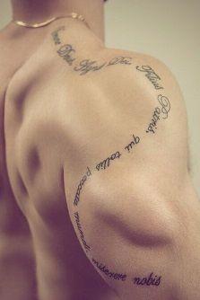 shoulder-tattoos-men-curved-lettering