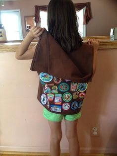 How to handle too many fun patches on a Girl Scout vest: create a cape using a second vest (clip the front flaps off, and sew the top to the top of the back of the original vest). Clever!
