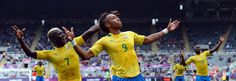Gabon's Pierre Aubameyang (C) celebrates with teammates after scoring during the 2012 Olympic mens football match between Gabon and Switzerland at St James' Park in Newcastle-upon-Tyne, north-east England on July 26, 2012. AFP PHOTO/PAUL ELLISPAUL ELLIS/AFP/GettyImages