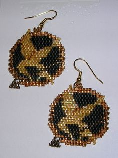 Hunger Games Earrings.  I haven't read/ seen The Hunger Games, but this beading is fantastic!  @gracia fraile Gomez-Cortazar Christman:  you need to get your ears pierced so I can make these for ya! :)