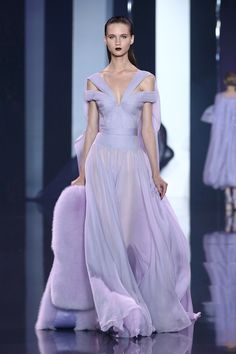 Lavender silk chiffon pleated off-the-shoulder gown with sash draping.