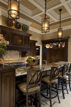 dark wood, granite, light trim, cool pendants and a great ceiling that draws your attention UP!
