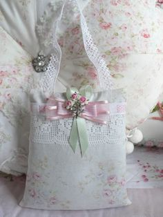 lavender sachet with lace, roses, rhinestone button and ribbons.