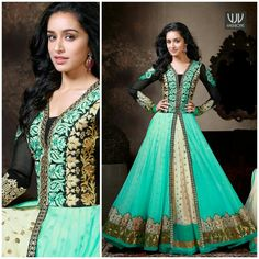 Buy Now @ http://goo.gl/tj476H Bollywood Shraddha Kapoor Turquoise Resham Work Length Anarkali Salwar Suit Shraddha Kapoor donned in this Turquoise and cream shade faux georgette layered floor length semi stitched anarkali suit. Contrasting yoke beautified with heavily resham and crystals embellished foliage patterns amasses the charm. Center slit of the first layer portrays sequined buttis on the second layer. Contrasting hemline patches proliferate the beauty of the attire.