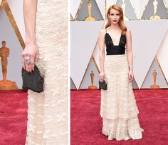 Emma Roberts with a Armani Privé Vintage Clutch at the academy awards.