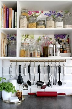 IKEA GRUNDTAL Kitchen Organizing Ideas. This super slim storage hub can easily squeeze onto a tiny kitchen wall without taking up an inch of floor space. | Apartment Therapy
