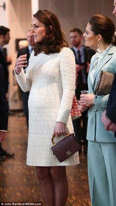 Kate's elegant metallic wool-blend bouclé-tweed midi dress from Alexander McQueen...