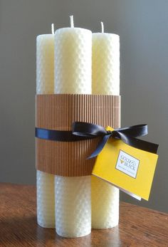 Home-made rolled beeswax candles as wedding favours - very easy to make and only about $1 per person!