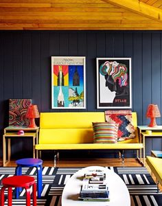 A rainbow of primary colors is just right for this Mid-Century modern room design. And what can wake up an already color-filled room? Yes, you can with a graphic black and white rug that makes the other colors pop even more.