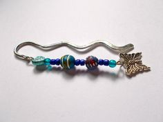 Silver Mini Wavy Bookmark with Ethnic Beads & Butterfly Charm - Length 9cm approx by NomvulaCrafts on Etsy