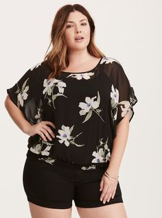 """Florals are groundbreaking year-around and this top proves it. The sheer black chiffon top sports flattering dolman sleeves and a curve-hugging banded bottom. The floral print is never fussy, with muted hues and a looks-hand-painted aesthetic.<div><br></div><div><b>Model is 5'9"""", size 1<br></b><div><ul><li style=""""list-style-position: inside !important; list-style-type: disc !important"""">Siz..."""