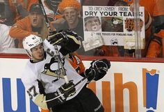 Crosby takes a hit from Philadelpha's Claude Giroux  *ive been goin to games for 24 years & this is one of the best signs I've ever seen!!