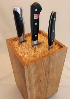 Fill an old box with skewers to make an universal knife block.