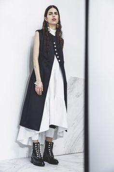 7 Winter Skirt Outfits Because Jeans Don't Keep You from Freezing Anyway Here's how to wear a skirt over a skirt:  Following 3.1 Phillip Lim's lead, take last summer's shirtdress, pop it on mostly unbuttoned over a tissue turtleneck, then pull on a peasant-scented skirt underneath for a petticoat effect.