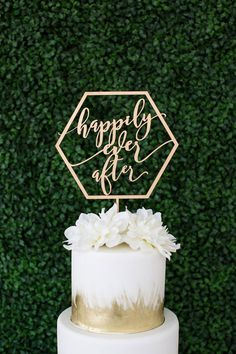 """Gold metallic geometric laser cut """"happily ever after"""" wood topper by Let's Tie The Knot"""