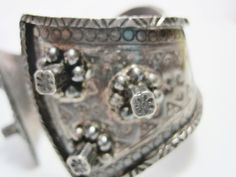 An intriguing find, this flared bracelet was most likely made in Algeria. I believe in the early decades of the Twentieth Century at the height of French colonial rule in North Africa which lasted from 1830-1962. The cuff is made with definite nods to the Kabyle jewelry of the Ouled Nail. There are echoes of this particular tribes defensive bracelets which have the characteristic square-ish studs. This bracelet however, was not made for the Ouled Nail women, rather embellished by local…