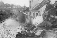 Tanks T-34-85 with troops on the armor are offensive in East Prussia. The 2nd Belorussian front,1945