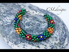 Make your own flower beaded kumihimo bracelet . Free tutorial with pictures on how to bead a seed bead bracelet in under 90 minutes by beading, braiding, and jewelrymaking with seed beads, cord, and cord ends. Inspired by summer holidays and flowers. H...