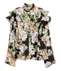 Black/tiger. Wide-cut blouse in soft, woven viscose fabric with a printed pattern. Small, ruffle-trimmed stand-up collar and decorative ruffles at front and