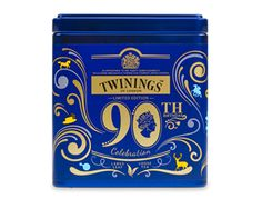 Twinings of London Queens 90th Birthday Celebration Tea tin ... limited edition commemorative celebrating Queen Elizabeth II's 90th birthday (April 21, 2016), decorated with royal symbols in gold on royal blue, with insignia EIIR (Elizabeth Regina Secondo) embossed on lid and royal warrant symbol on the front, 2016, UK