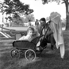 "Vice President Lyndon B. Johnson (LBJ) presents a new pony, ""Tex"" to Caroline Kennedy (CBK); children playing on the South Lawn - John F. Kennedy Presidential Library & Museum"