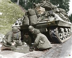 M 10 tank destroyer crew plays craps while waiting for a road block to be removed, 4 Dec 1944.