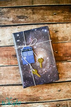 What better way to wrap a book present (books are bigger on the inside!) than by wrapping it up in space wrapping paper (tutorial on how to make it!) and with a Doctor Who TARDIS tag (complete with keys!).  #lovethriftbooks #clevergirls #giftwrap