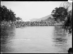 Regatta on the Waikato River at Ngaruawahia, circa Across the river marquees are visible, with crowds of people lining the river bank. River Bank, Historical Photos, New Zealand, Beach, Water, Outdoor, Historical Pictures, Gripe Water, Outdoors