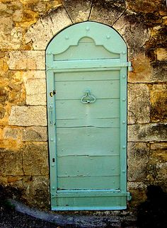 Old door in France - photo by Jean Pierre Chatot.