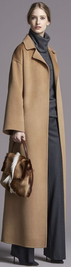 Beautiful Carolina Herrera coat, cowl, and slacks. NOT HAPPY about the Springbok Antelope hide bag however!!!