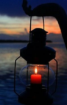 Candle at sunset.
