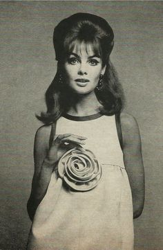 1965, Jean Shrimpton .Saint Laurent's rose pink gaberdine short dinner dress, bound in emerald green, gathered onto a bias skirt edged in green at the hem.