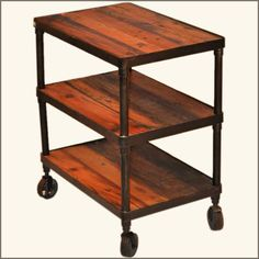 This industrial vintage cart makes an impressive statement. It is built with seasoned old wood and ultra-durable black wrought iron. The cart also includes industrial quality rollers.