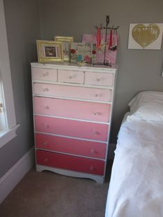 Love this Ombre Painted Dresser with Graduated Color Scheme.  Inspired by Paint Strips/Paint Chips -- use all the colors on a paint strip.  Top drawer is the palest color & each drawer is just a brighter shade of the previous as you work your way down.  Creates a colorful look without being over the top.  Could do with any color.