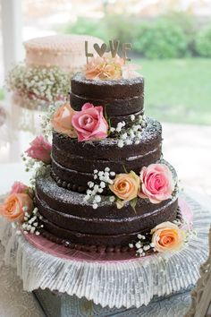 Keep it sweet and simple with a naked chocolate ganache wedding cake. Sprinkle powdered sugar onto the tiers, decorate with colorful, fresh flowers, and finish it off with a simple cake topper. Wedding Cake Photos, Cool Wedding Cakes, Wedding Cake Designs, Homemade Wedding Cakes, Pretty Cakes, Beautiful Cakes, Bolos Naked Cake, Delicious Chocolate, Chocolate Ganache