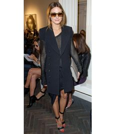 WHO: Olivia Palermo WHAT: Spotted front row at the Emilia Wickstead S/S 14 show. WEAR: Ray-Ban sunglasses; Tibi sandals.