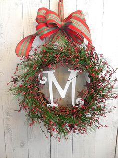 How to Make a Monogram Christmas Wreath. Watch the tutorial and learn creative twists on holiday monogram wreath ideas with Martha Stewart. #wreaths #christmas
