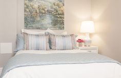 Calming bedroom with a neutral colour palette. From season 10 of HGTV's Income Property
